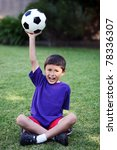 young boy holds up soccer ball... | Shutterstock . vector #78336307
