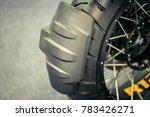 mud flap behind motorcycle. | Shutterstock . vector #783426271