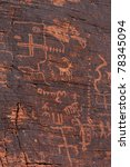 fire canyon weathered fading ancient indian petroglyphs - stock photo