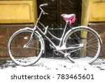 A Bicycle Covered With Snow In...