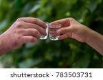 two hands clinking shots of... | Shutterstock . vector #783503731