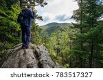 woman looking over a cliff on... | Shutterstock . vector #783517327
