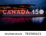 """Small photo of Vancouver, Canada - December, 2017: """"CANADA 150"""" anniversary celebration sign with illuminated place near Canada Place in Vancouver, British Columbia"""