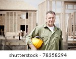 Rugged Male Construction Workers on the jobsite - stock photo