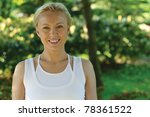 Portrait of yoga trainer in park - stock photo