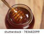 pouring organic honey from... | Shutterstock . vector #783682099