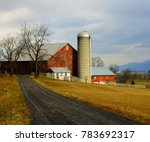 A Colour Image Of A Red Barn I...