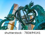 Qingdao city center square Chinese sculpture dragon and skyscrap