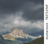 Small photo of Stage six of Alta Via 1 trail from Passo Giau to Rifugio Citta di Fiume on a dark, rainy and cloudy day with view of Ra Gusela, Torre Grande & Tofane mountains, Dolomites, Belluno province, Italy