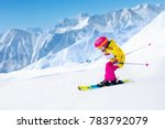 child skiing in mountains.... | Shutterstock . vector #783792079