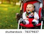 Baby In Sitting Stroller On...