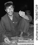 Small photo of Helmand Province / Afghanistan - September 5, 2008: Afghan man smoking