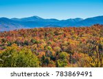 fall color around lake placid ny | Shutterstock . vector #783869491