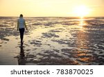 A Young Woman Walks Across The...
