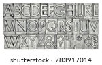 Small photo of English alphabet, dollar, cent and punctuation signs in vintage metal type, black and white image with platinum toning