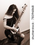 Woman with bass guitar, sepia - stock photo