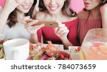 women take picture with food in ... | Shutterstock . vector #784073659