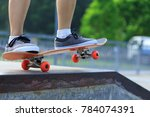 female skateboarder legs...   Shutterstock . vector #784074391