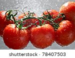 Ripe Tomatoes In Water Drops