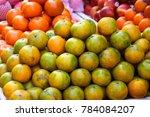 stacks of oranges on display... | Shutterstock . vector #784084207