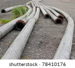 Long metal pipes: Interesting flowing patterns formed by long curving metal industrial pipes - stock photo