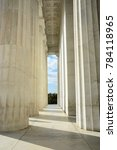Small photo of Close up portrait orientation exterior shot of the white marble Greek Doric colonnade of columns of the Lincoln Memorial, Washington DC, USA