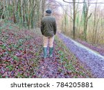 Small photo of Male ambler hiking in forest on winter day in Sussex, England