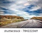 winding mountain road through... | Shutterstock . vector #784222369