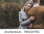 young girl hugs guy   s back... | Shutterstock . vector #784224781