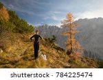 young woman trekker is admiring ... | Shutterstock . vector #784225474