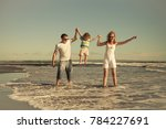 happy family walking on the... | Shutterstock . vector #784227691