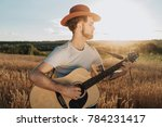 young bearded man in hat with... | Shutterstock . vector #784231417