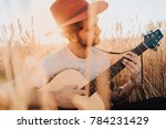 Young Bearded Man In Hat With...