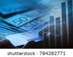 man hand on a laptop keyboard.... | Shutterstock . vector #784282771