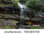 A Roadside Waterfall Trickling...