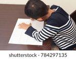 japanese boy doing homework ... | Shutterstock . vector #784297135