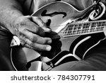 Man Playing A Mandolin In Blac...