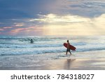surfer at sunrise | Shutterstock . vector #784318027