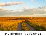 Small photo of Gravel pathway on Wah'Kon-Tah Prairie towards sunset