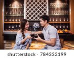 young couple clinking their...   Shutterstock . vector #784332199