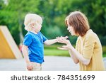 mother comforting her crying... | Shutterstock . vector #784351699