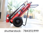 fire extinguisher on blur... | Shutterstock . vector #784351999