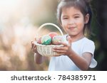 happy asian child girl holding... | Shutterstock . vector #784385971