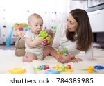 funny baby boy and young woman... | Shutterstock . vector #784389985