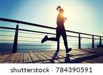 sporty female jogger morning... | Shutterstock . vector #784390591
