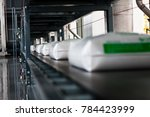 white bag on conveyor line in... | Shutterstock . vector #784423999