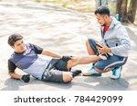 sport man helping his friend ... | Shutterstock . vector #784429099