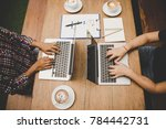 top view two man are working on ... | Shutterstock . vector #784442731