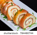 salmon rolls with chives on a... | Shutterstock . vector #784480744