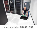 technician lifting floor tile... | Shutterstock . vector #784511851